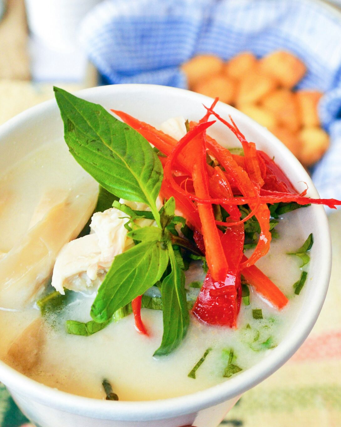 Poached chicken, coconut & galingal soup (photo by Kaleem Hyder)